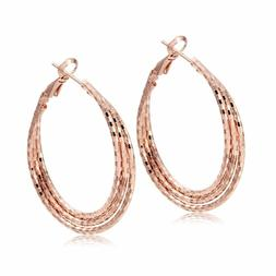 Breathtaking rose gold plated Triple row twisted 1 1/2 inch